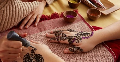 Hands can be adorned with designer henna all the way up to elbows; opt to treat digits only thanks to a classic or gelish mani-pedi for AED89.00 at Discount Sales.